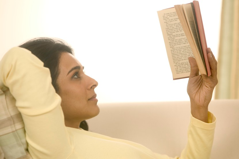 Woman Reading a Book at Home February 12, 2004