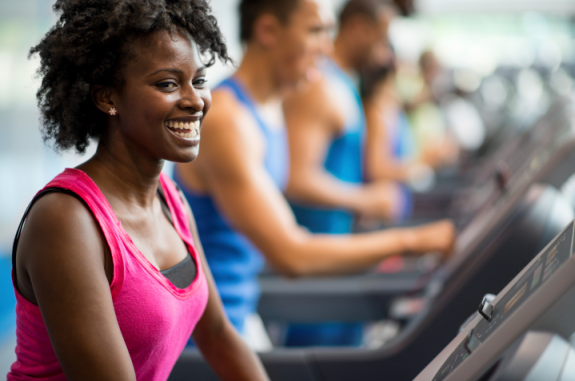 smiling-woman-on-treadmill-at-gym