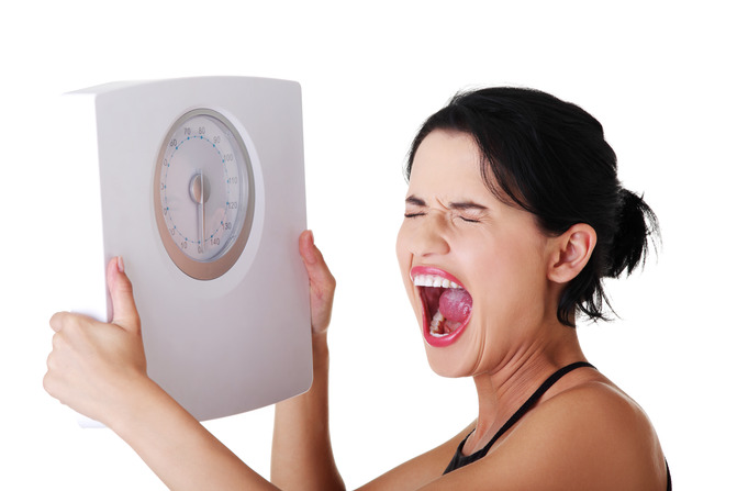 Frustrated-woman-with-scale