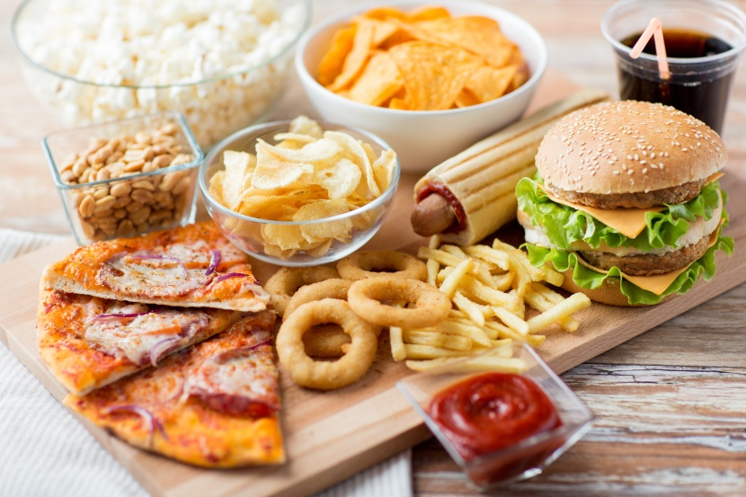 close up of fast food snacks and drink on table