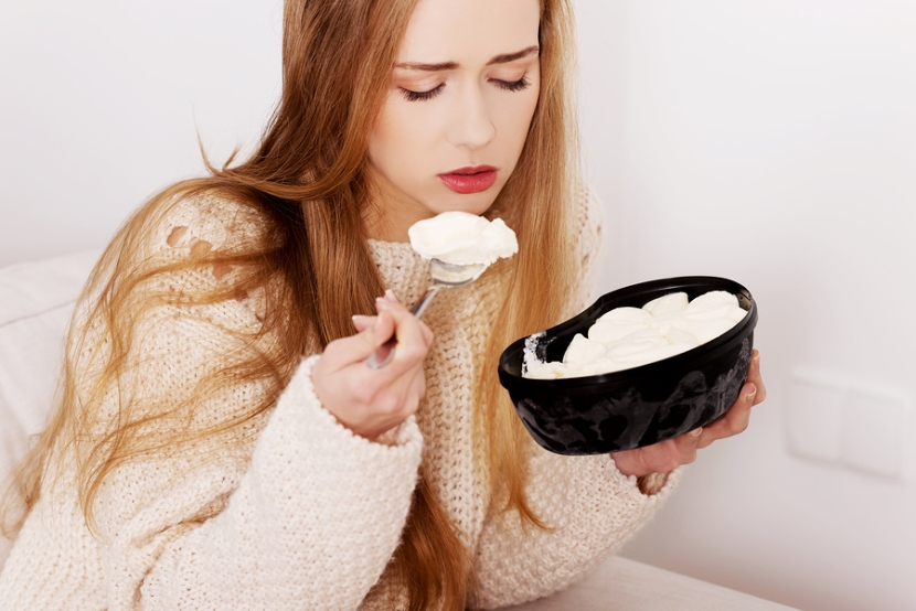 Woman eating ice cream for a better humor